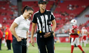 Arizona Cardinals training camp assistant linebackers coach Jen Welter, left, talks with line judge Sarah Thomas prior to an NFL preseason football game between the Cardinals and the Kansas City Chiefs on Saturday, Aug. 15, 2015, in Glendale, Ariz. (AP Photo/Ross D. Franklin) ORG XMIT: AZRF102